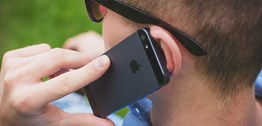 Close-up image of a man listening on a phone